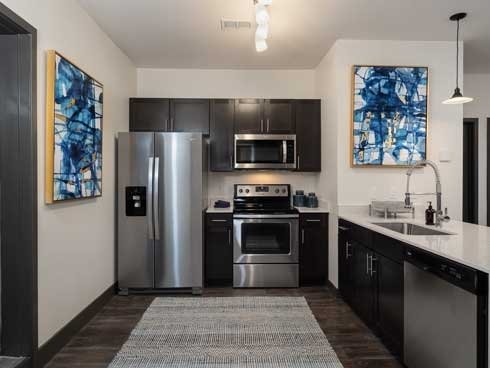 23West Kitchen with stainless steel appliances