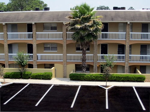 Spanish Trace Apartments Exterior with Grounds
