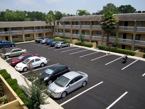 Spanish Trace Apartments Exterior with Parking