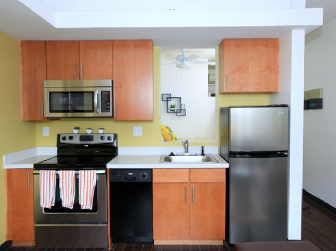 The Continuum Apartments Kitchen with Stainless Steel Appliances