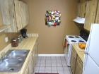 The Gardens Apartments Kitchen with Icemaker Refrigerator